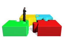 Standing on top of puzzles Royalty Free Stock Photography