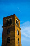 Standing Tower near downtown Austin Texas Jet Contrail. Over the bell tower with blue skies above stock photos