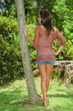 Standing by a tree Royalty Free Stock Photos