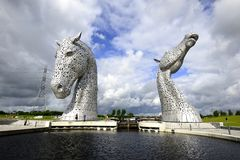 Standing under the Kelpies Stock Images