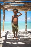 Standing underneath a wooden structure at a tropical island. Bintang Biru Island, Sabah Malaysia : May 1st, 2016 - Portrait shot of a shirtless boy underneath a royalty free stock photography