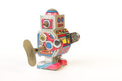 Standing vintage tin robot, side view with key Stock Image