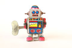 standing vintage tin robot, straight face with key Royalty Free Stock Image