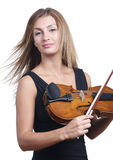 Standing violin play. A standing woman dressed for the symphony finishes playing her violin Stock Images
