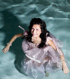 Standing in water in dress smile Stock Photos