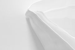 Standing white cloth napkin with ironed folds Royalty Free Stock Image