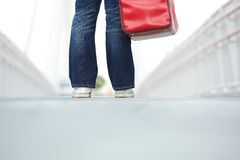 Standing woman with bag outdoors Stock Image