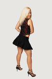 Standing woman in black mini skirt. A young pretty woman standing in black mini skirt and having fun Stock Photos