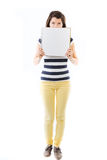 Standing woman with blank page Royalty Free Stock Image