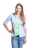 Standing woman with blond hair in casual clothes Royalty Free Stock Photos