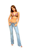 Standing woman in bra and jeans. An very fit woman in a nice bra and jeans standing in an Stock Image