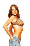 Standing woman in bra and jeans. Stock Photography