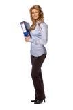 Standing woman carrying binder Royalty Free Stock Photos