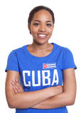 Standing woman from Cuba with crossed arms Stock Photos