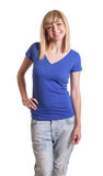 Standing woman with dark eyes and blue jeans Stock Image