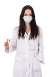 Standing woman doctor with stethoscope Stock Image