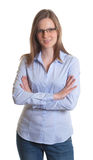 Standing woman with glasses and crossed arms Stock Image
