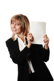 Standing woman holding brochure. Cheerful standing woman in black and white office clothing holding white brochure. Room for text, or your own message. Brochure Stock Image