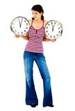 Standing woman holding clocks Royalty Free Stock Image