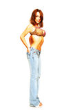 Standing woman in jeans and bra. royalty free stock photos