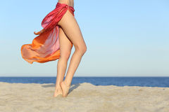 Standing woman legs posing on the beach wearing a pareo. With the horizon in the background royalty free stock photography