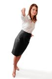 Standing woman points top-down. Studio portraite of standing woman pointing top-down Royalty Free Stock Photography