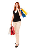 Standing woman after shopping. Frontal shot. Beautiful woman with four shopping bags, two of the them at the shoulder level. Frontal shot, isolated stock photo