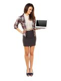Standing Woman Showing Laptop's Empty Screen Royalty Free Stock Images