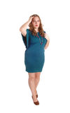Standing woman in turquoise dress. Royalty Free Stock Photography