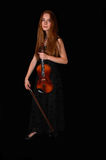 Standing woman with violin. Stock Images