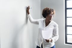 Standing Woman Writing on Wall royalty free stock photo