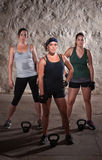 Standing Women Doing Boot Camp Style Workout. Pretty women pausing during a sweaty workout Royalty Free Stock Photography