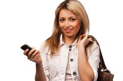 Standing  women with mobile phone, isolated Stock Photography