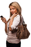 Standing women with mobile phone, isolated Royalty Free Stock Photos