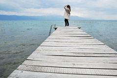Standing on wooden plank. Woman standing on wooden plank Stock Image
