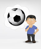 Standing young boy thinking about soccer ball  Stock Image