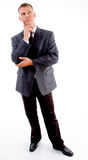Standing young businessman looking upward Royalty Free Stock Image