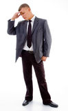 Standing young businessman in tension Stock Photo