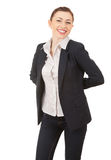 Standing young businesswoman in elegant clothes Stock Images