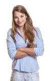 Standing young businesswoman with long blond hair Stock Photos