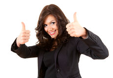 Standing young businesswoman with thumbs up Royalty Free Stock Photography