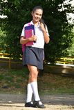 Standing Young Colombian Girl Student Wearing Uniform With Books