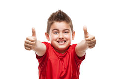Standing young cool boy doing thumbs-up Royalty Free Stock Photos