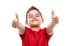 Standing young cool boy doing thumbs-up Stock Photos