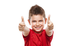 Standing young cool boy doing thumbs-up Stock Image