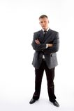 Standing Young Executive With Crossed Arms Royalty Free Stock Image