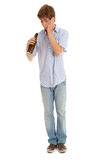 Standing young man with bottle of beer Stock Photo
