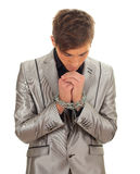 Standing young man with chained hands Stock Image
