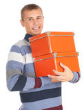 Standing young man with orange boxes Stock Images