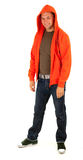 Standing young man in orange sweatshirt Stock Photo
